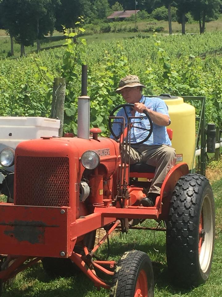 Steve Thompson on his Dad's first tractor at Nottely River Valley Vineyards - Murphy, NC